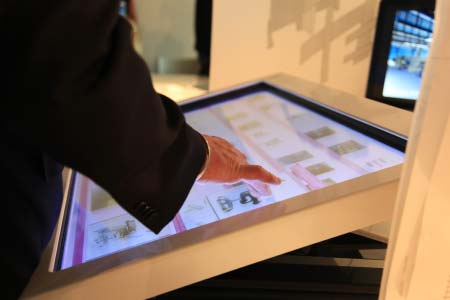 Person interacting with interactive touchscreen map