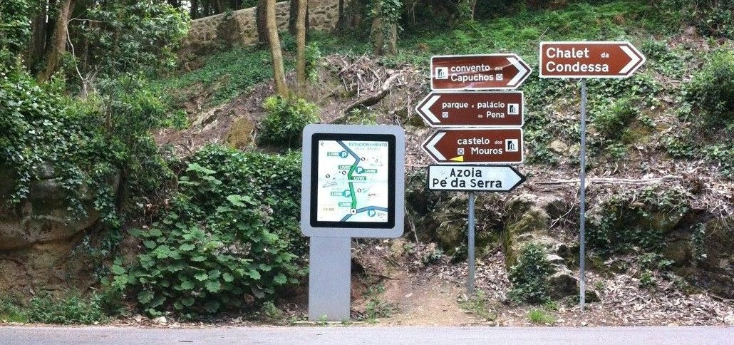 Outdoor kiosk at the side of a road displaying a map