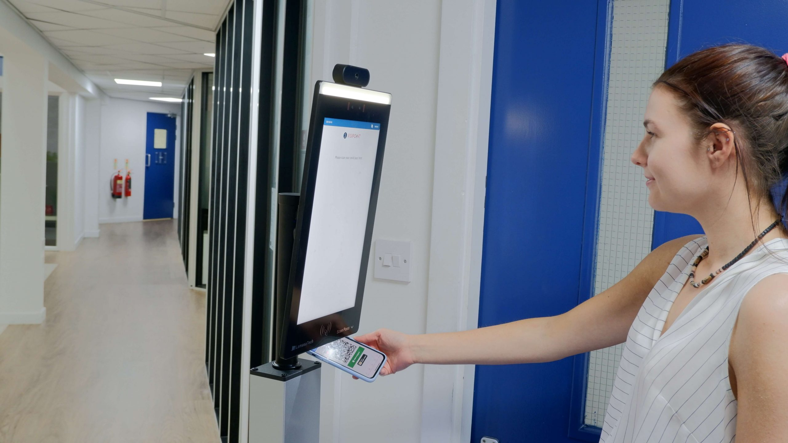 Person Scanning Covid-19 vaccination pass on kiosk